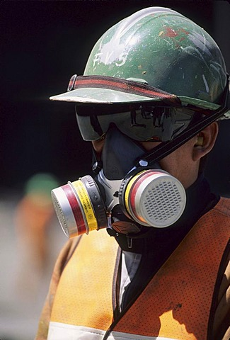 CHL, Chile, Atacama Desert: the Chuquicamata copper mine near Calama, a mine worker with protective mask.