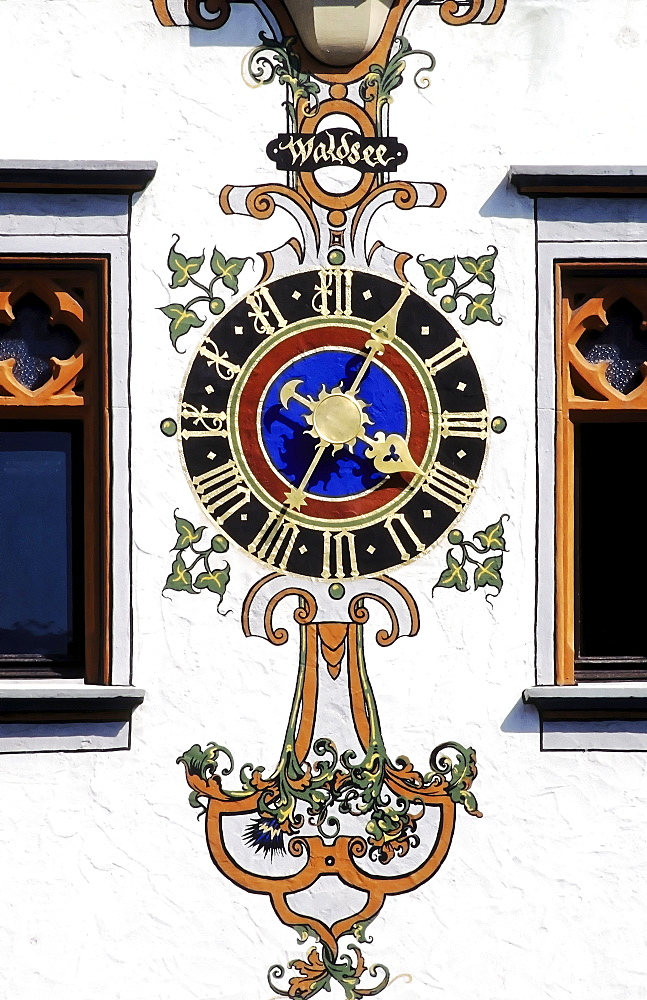 Ornate clock on the facade of the Gothic town hall in Bad Waldsee, Upper Swabia, Baden-Wuerttemberg, Germany, Europe