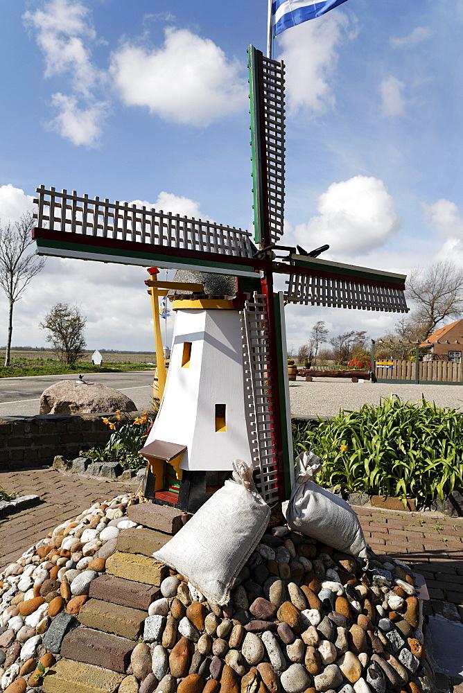 Windmill model decorating a front yard in Walcheren, Zeeland, Netherlands