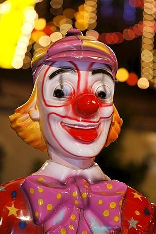 Figure of a clown, merry-go-round, Rhine funfair, Duesseldorf, NRW, Germany