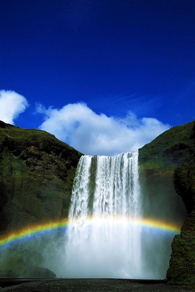 Rainbow over Skogafoss Waterfall, Iceland, Atlantic Ocean