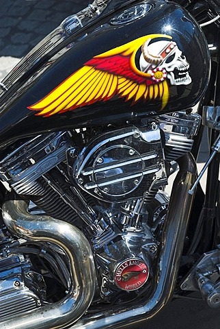 Painting of skull on the fuel tank of a Harley Davidson motorbike