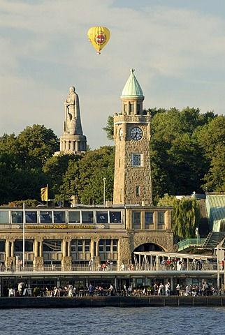 Hot-air ballon passing Landungsbrucken und Bismark Memorial at Hamburg Harbour, Hamburg, Germany