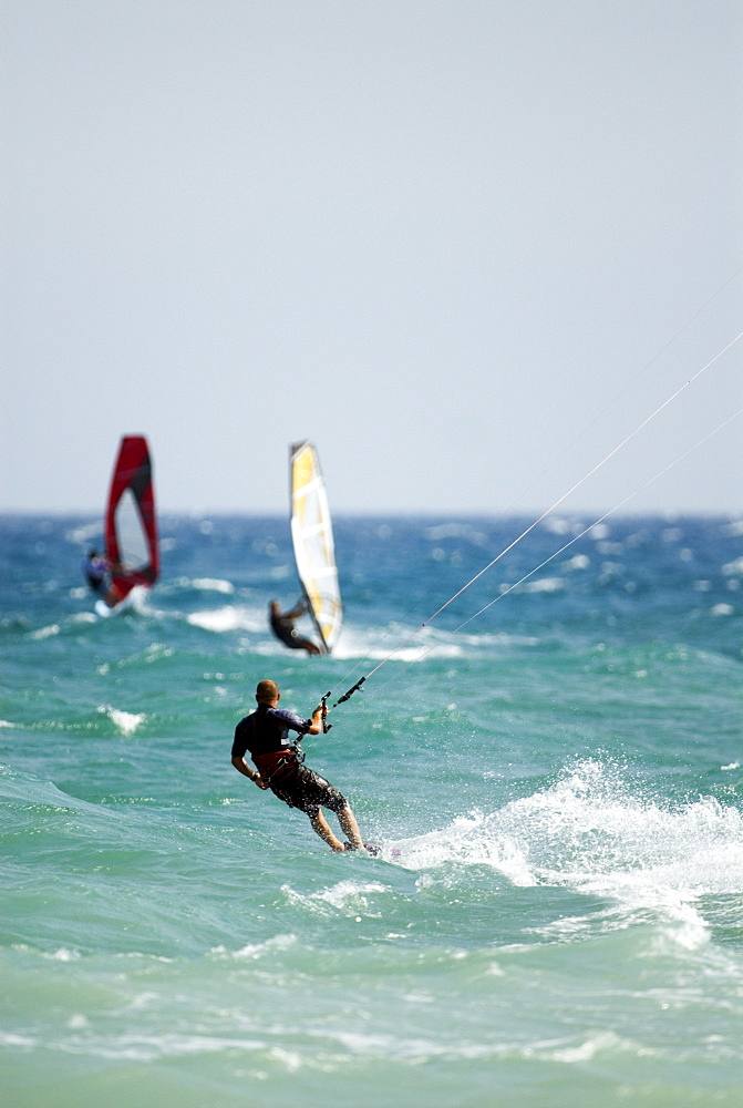 Kitesurfer and windsurfers, Mediterranean coast, Spain