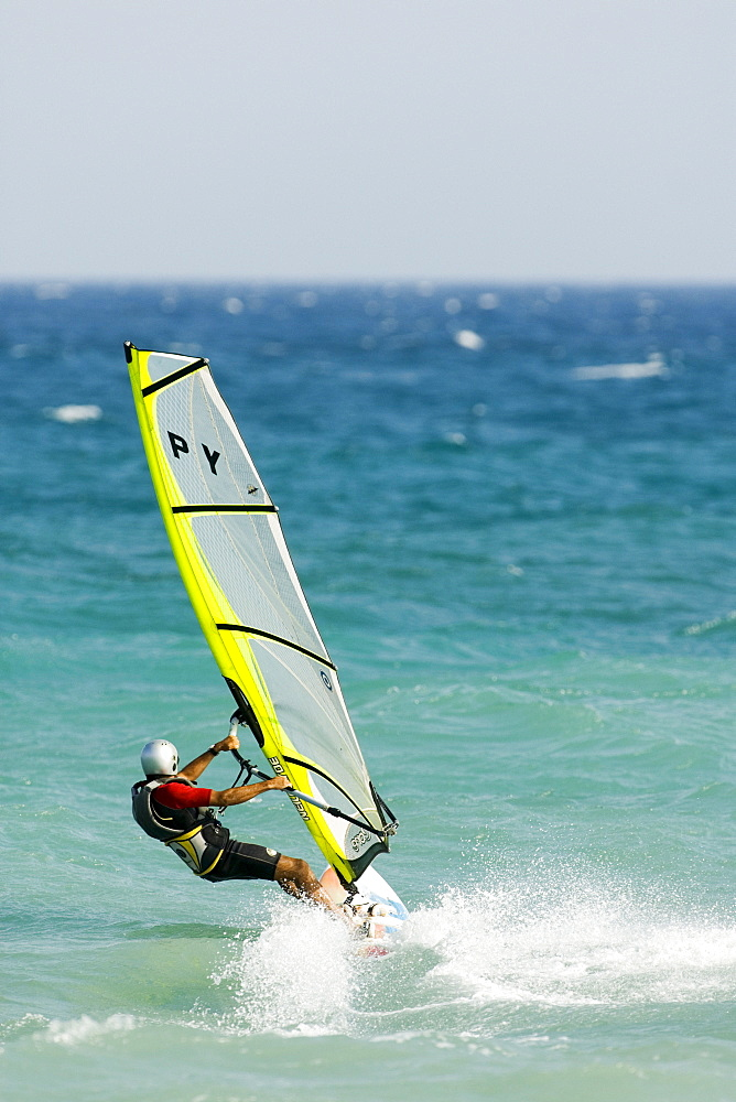 Windsurfer wearing helmet, Mediterranean coast, Spain
