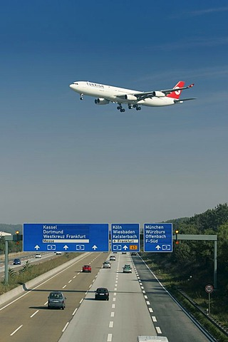 Aeroplane above the autobahn approaching the Airport, Frankfurt, Hesse, Germany