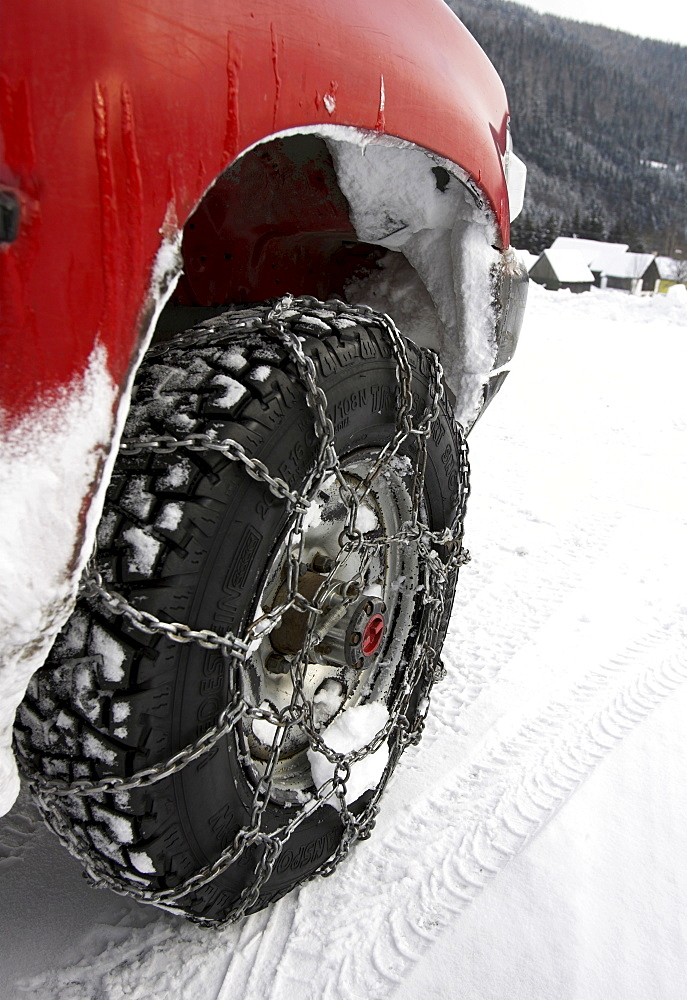 Car with snow chains, Germany.