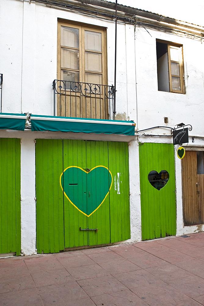 Hearts painted on doors, historic city centre, Eivissa, Ibiza, Balearic Islands, Spain