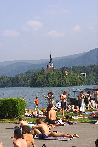 Beach at Lake Bled with St. Marie's Church on the iland - Slovenia