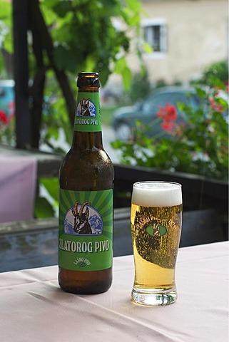 Beer bottle and glass of Lasko beer Zlatorog Pivo - Slovenia