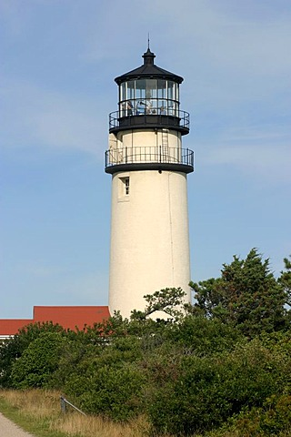 Highland Light (Cape Cod Light). The station was established in 1797, the present buildings date from 1857. At that time, the lighthouse was still 150m away from the 40m cliffs, but continuing erosion imperiled the location. At the end of the 20th century