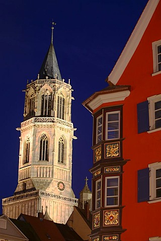 Church and bay windows at night of historical houses in Rottweil, Baden-Wurttemberg, Germany