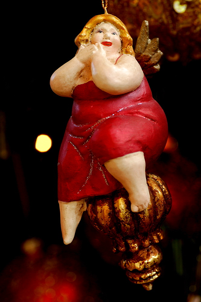 Christmas ornament, figure of a plump woman wearing red dress