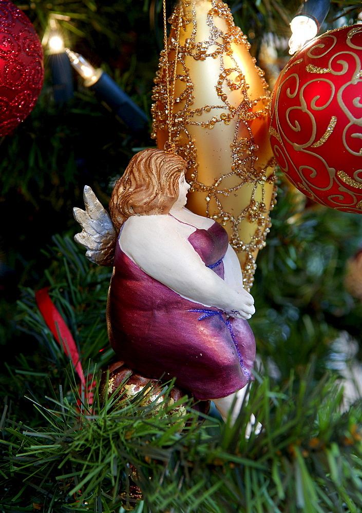 Christmas ornament, Christmas balls and figure of a plump woman wearing purple dress