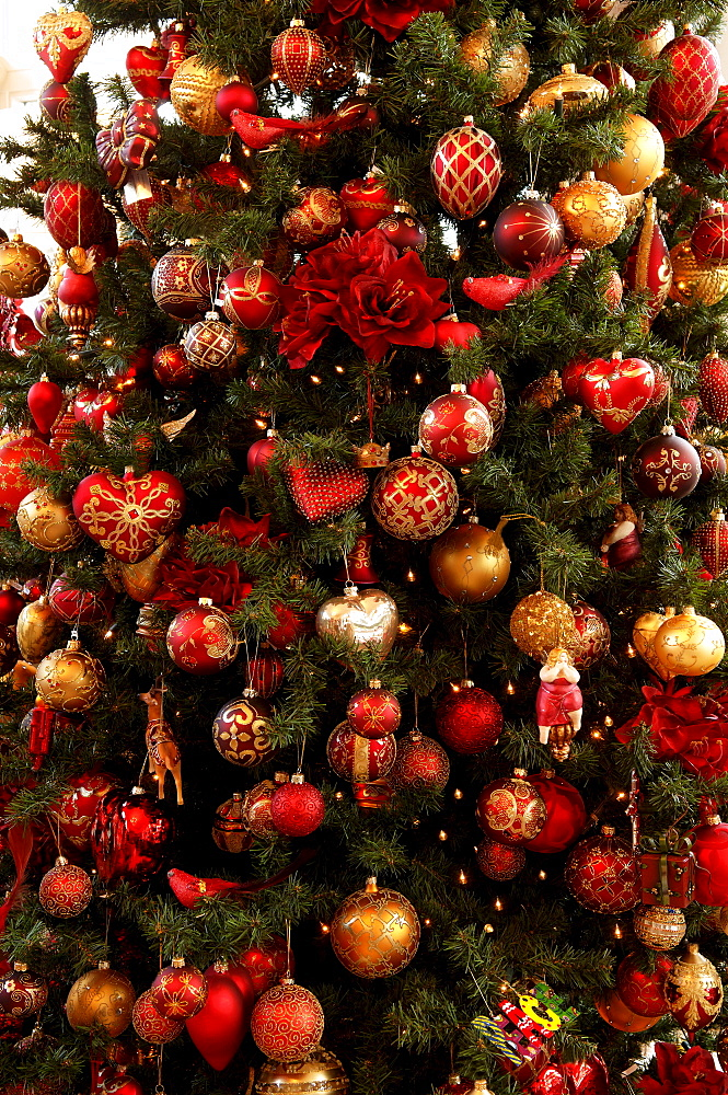 Detail shot, colourful Christmas ornaments hanging in Christmas tree