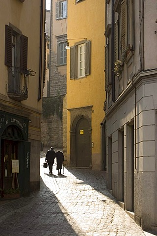 Couple in the old part of town, Bergamo, Lombardy, Italy