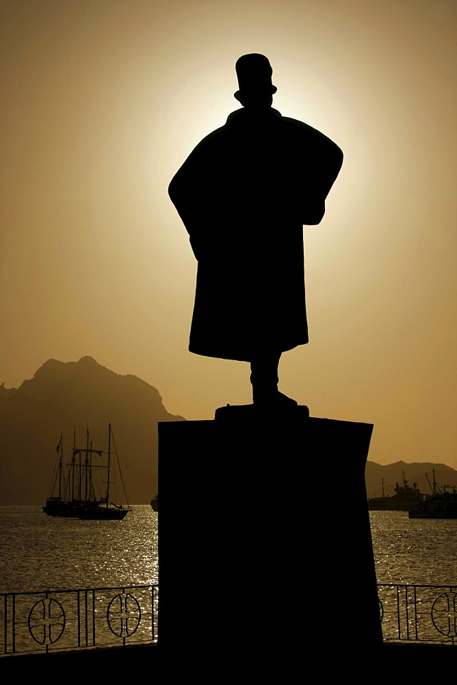 Silhouette of the monument to Alfonso Diogo in front of yachts moored in the bay of Mindelo on Sao Vicente Island, Cape Verde Islands, Cape Verde, Africa