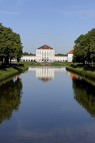 Canal of Castle Nymphenburg with parkway and middle part of Castle Nymphenburg in Munich, Upper Bavaria, Bavaria, Germany