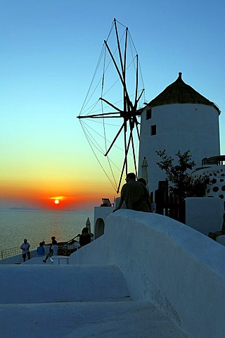 Mill with sunset in Oia in Santorin in the Aegean, Greece
