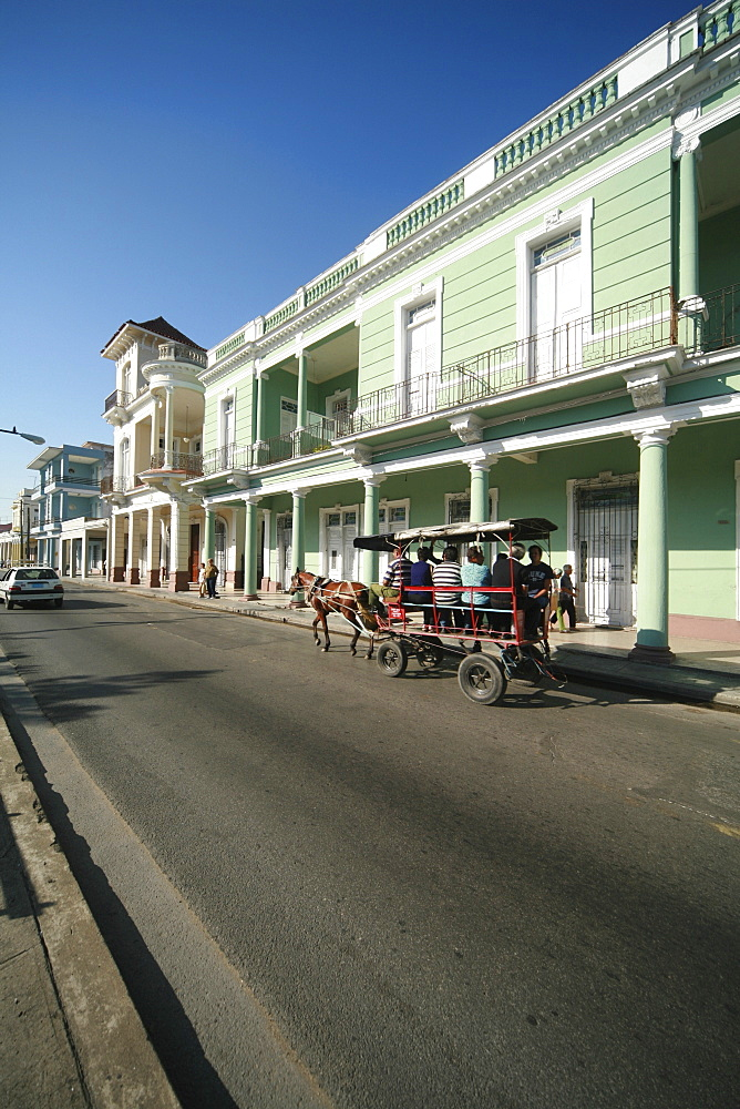 Colonial-style building lining a street in Cienfuegos, Cuba, Caribbean, Americas
