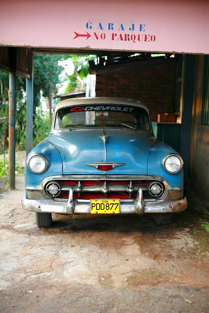 Vintage car in a garage in Vinales, Pinar del Rio Province, Cuba, Latin America