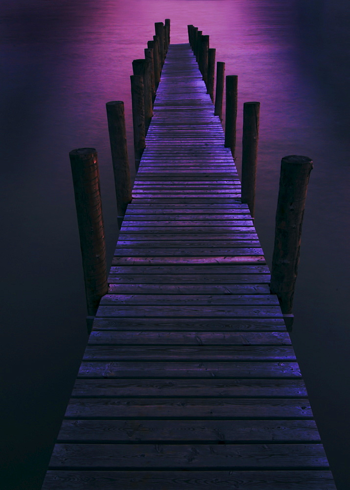 Boardwalk on a lake at night, Neusiedler Lake, Burgenland, Austria