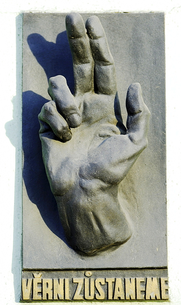 Hand sulpture on a building facade in the historic centre of Prague, Czech Republic, Europe