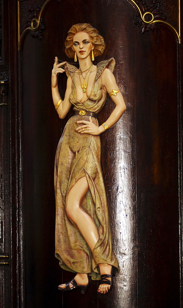 Wooden figure on a store in the historic centre of Prague, Czech Republic, Europe