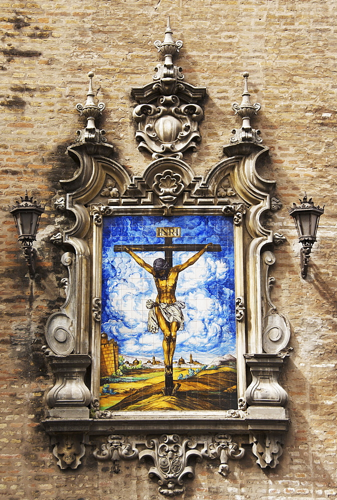 Picture of Jesus on the cross, ceramics, exterior wall of the church at Plaza de la Encarnacion, Seville, Andalusia, Spain