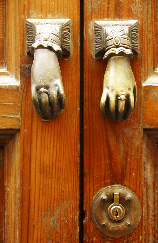 Two doorknobs, door handles on an old door, Seville, Andalusia, Spain