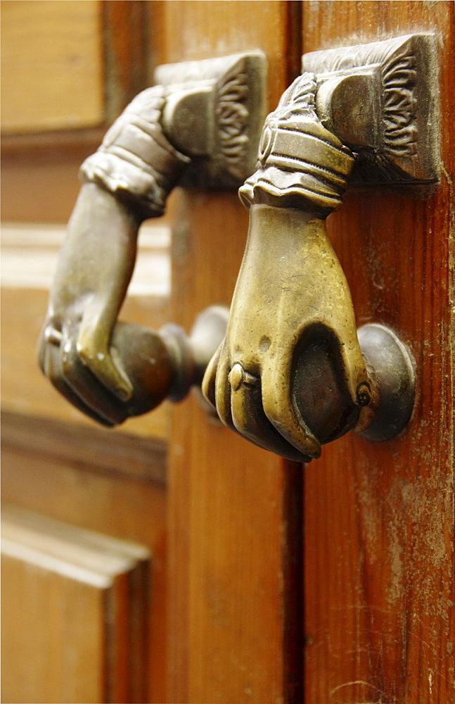 Two doorknobs, door handles on an old door, Seville, Andalusia, Spain