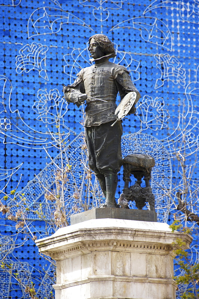 Diego Velasquez statue in front of a blue department store facade, Seville, Andalusia, Spain, Europe