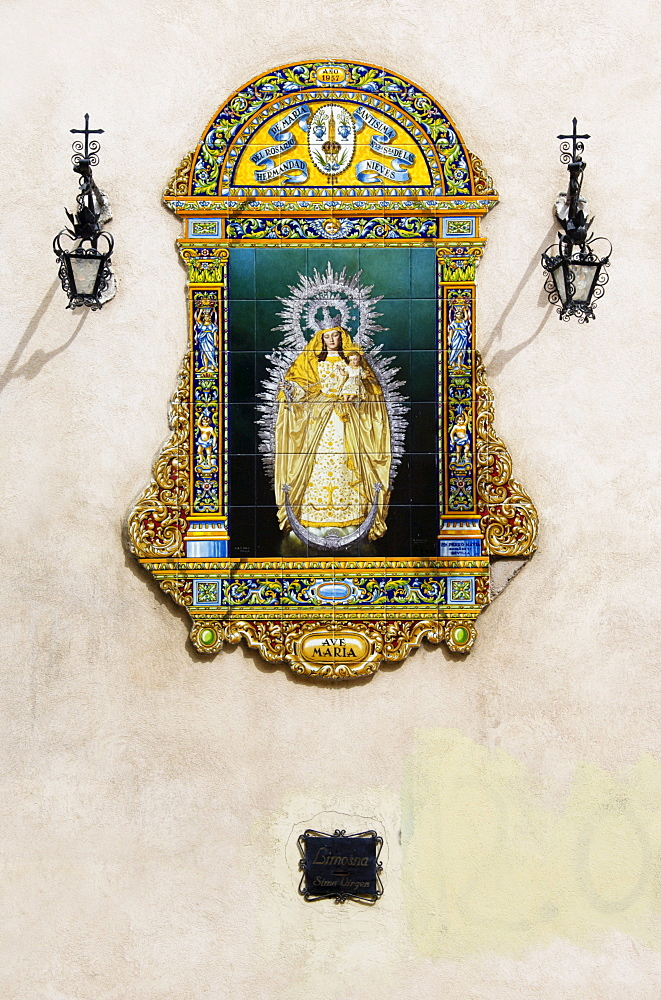 Image of St. Mary on ornate ceramic tiles, outside walls of a church in Seville, Andalusia, Spain, Europe