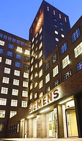 Wernerwerk multistory building in the evening, entrance, sign, Siemens AG, Berlin, Germany.