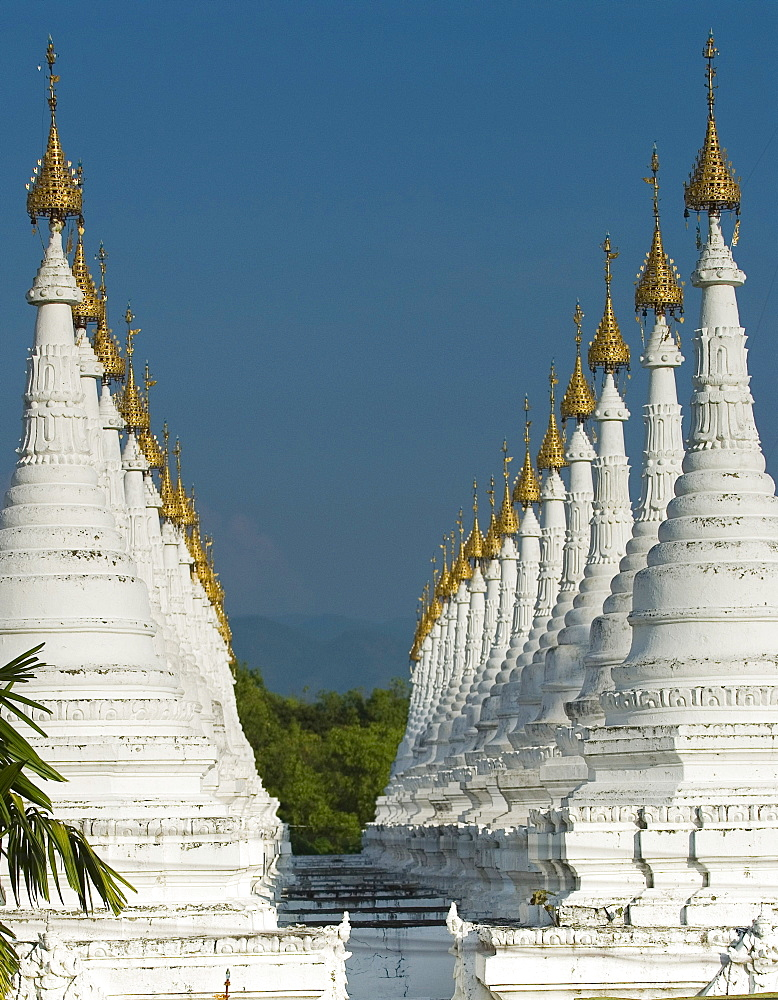 Lots of golden-tipped white stupas in two rows, Mandalay, Myanmar (Burma), Southeast Asia