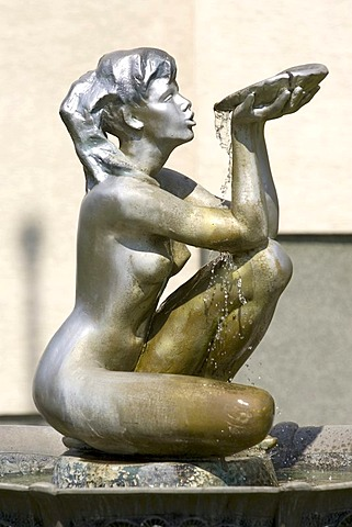 Figure of a fountain in front of a hotel in warshaw, poland