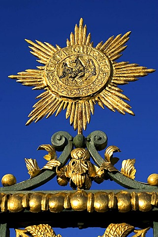 Golden sun with armof eagle castle Charlottenburg, Berlin, Germany