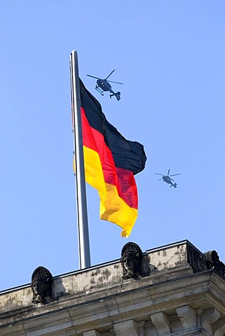 German flag with two helicopters, Reichstag, Berlin, Germany