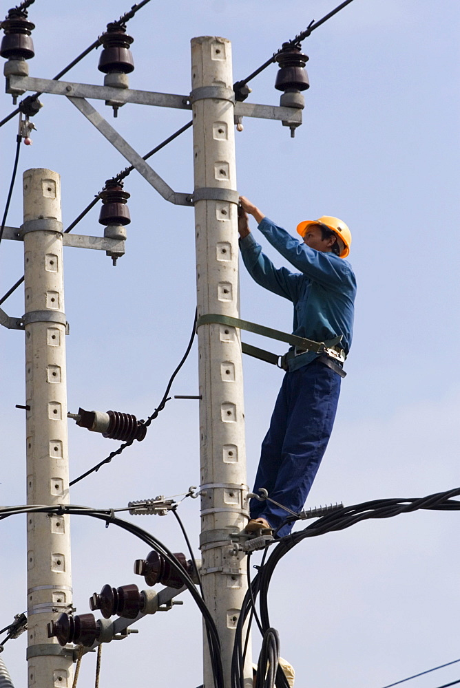 Electrician at work, Vietnam, Asia