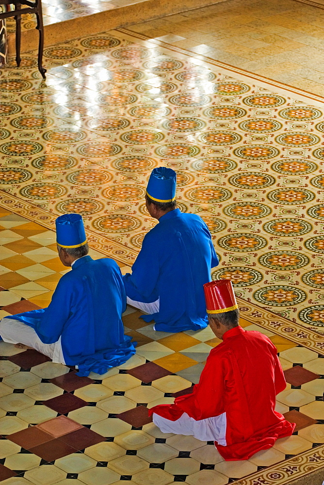 Praying members of the sect Cao Dai, Tay Ninh, Vietnam, Asia