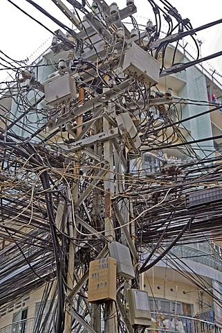 Tangled electrical and telephone cables in Saigon, Vietnam, Asia