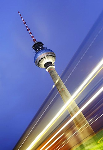 Time exposure of the Television Tower or Fernsehturm behind light streaks left by a passing car, Alexanderplatz, Berlin, Germany