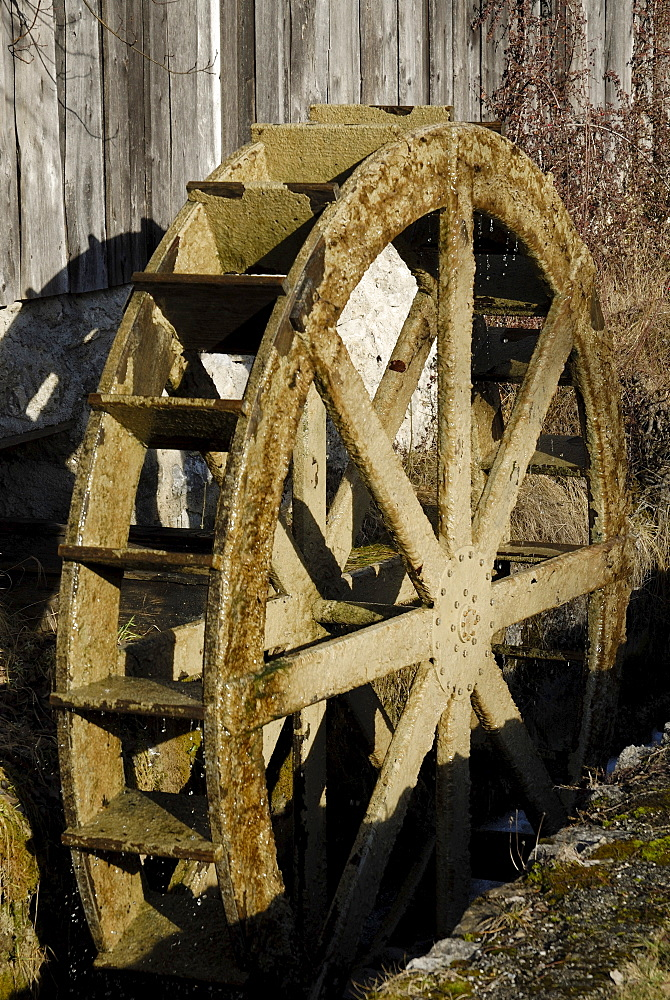 Wooden mill wheel at an old sawmill in Nussdorf, Bavaria, Germany, Europe