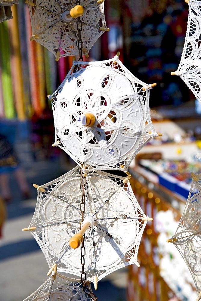 Umbrellas made of bobbin lace in a bobbin lace shop, Burano, Lagoon, Venice, Italy, Europe