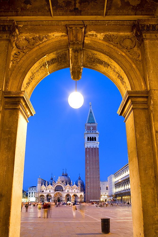 View through arcades towards Basilica di San Marco, St. Mark's Basilica and Campanile, evening mood, Venezia, Venice, Italy, Europe