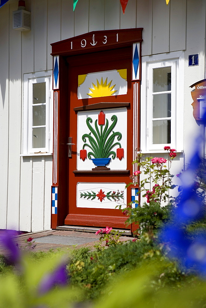 Colourfully painted door on the captain's house, Prerow, Darss, Mecklenburg-Western Pomerania, Germany, Europe