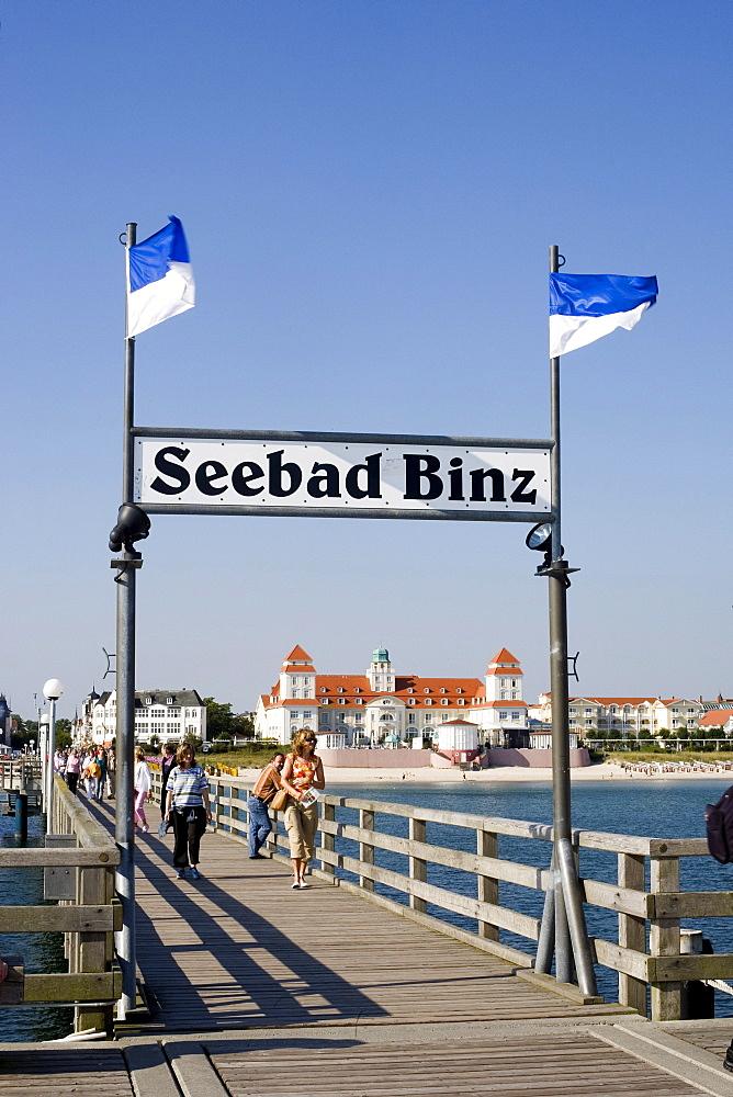Pier and kurhaus, sign indicating Seebad Binz or Binz Coastal Resort, Ruegen Island, Baltic Sea, Mecklenburg-Western Pomerania, Germany, Europe