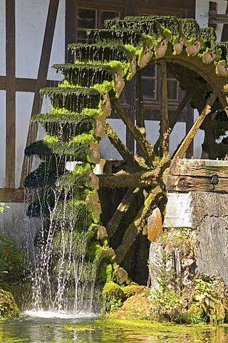 An old mill wheel near the Blautopf Spring, Blaubeuren, Baden-Wuerttemberg, Germany