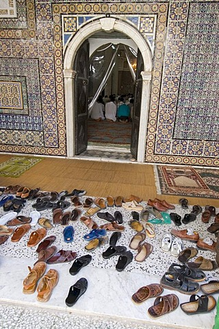 Shoes in front of a mosque in Tripolis, Tripoli, Libya