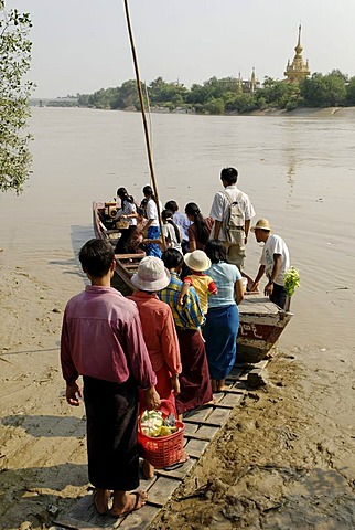 People entering a ferry over the Pazundaung river, Yangon, Myanmar